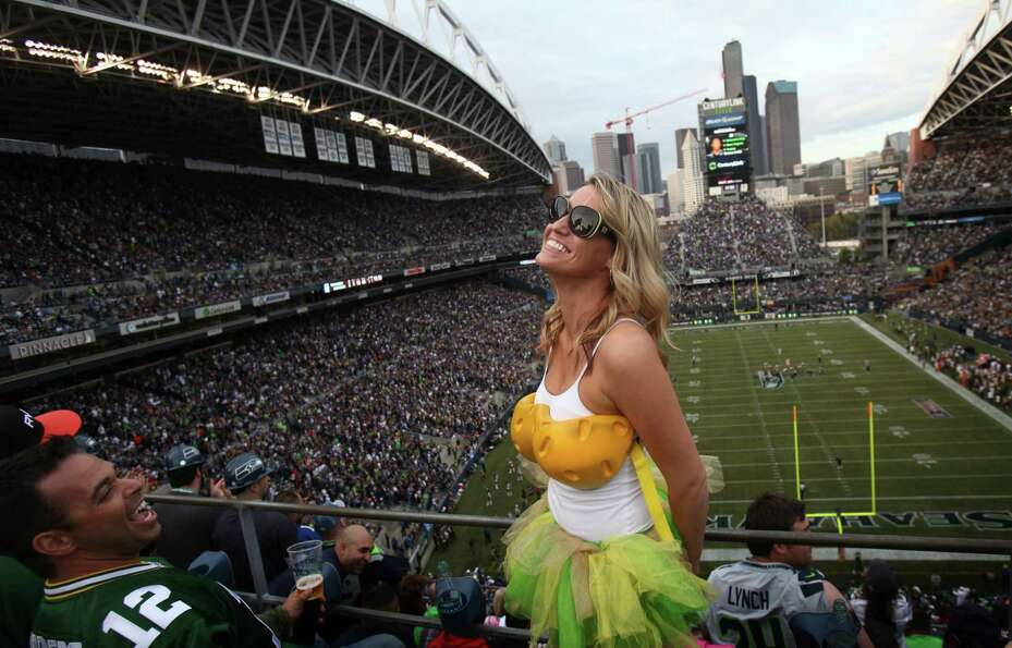 Green Bay Packers fan Sarah Hinkhouse wears a 'cheese top' during Monday Night Football against the