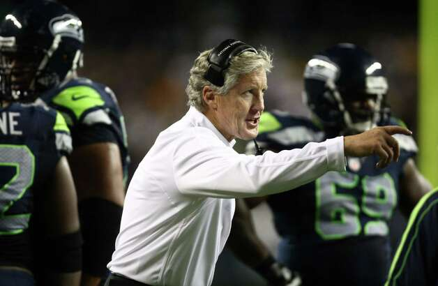 Seattle Seahawks coach Pete Carroll talks to his players as they play against the Green Bay Packers during Monday Night Football on September 24, 2012 at CenturyLink Field in Seattle. Photo: JOSHUA TRUJILLO / SEATTLEPI.COM