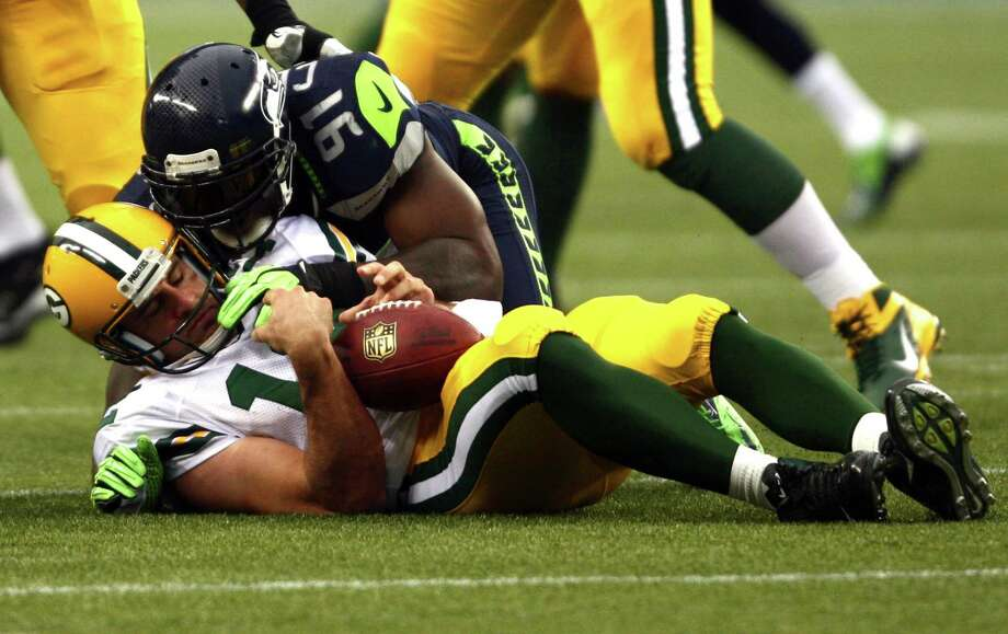 Green Bay Packers quarterback Aaron Rodgers is sacked by Seattle Seahawks player  Chris Clemons. Photo: JOSHUA TRUJILLO / SEATTLEPI.COM