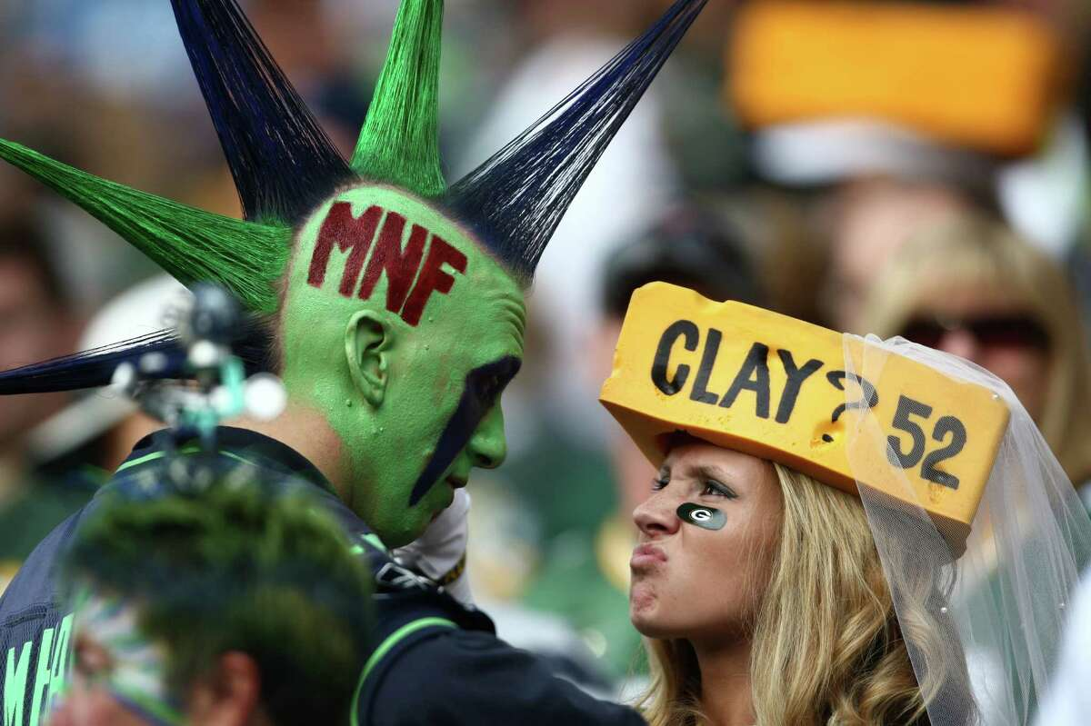 Seattle Seahawks fan Mr. Mohawk faces off with a Green Bay Packers fan during Monday Night Football on September 24, 2012 at CenturyLink Field in Seattle.