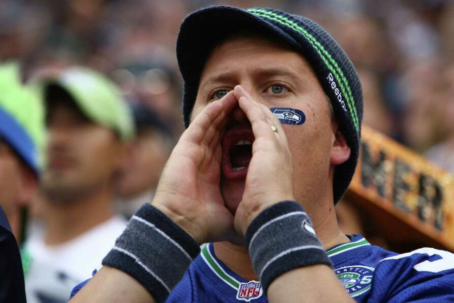 A Seahawks fan makes noise during a Green Bay Packers possession.
