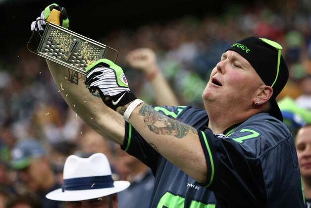 "Seattle Seahawks fan Lorin ""Big Lo"" Sandretzky grates cheese as the Hawks play the Green Bay Packers during Monday Night Football on September 24, 2012 at CenturyLink Field in Seattle. Photo: JOSHUA TRUJILLO / SEATTLEPI.COM"