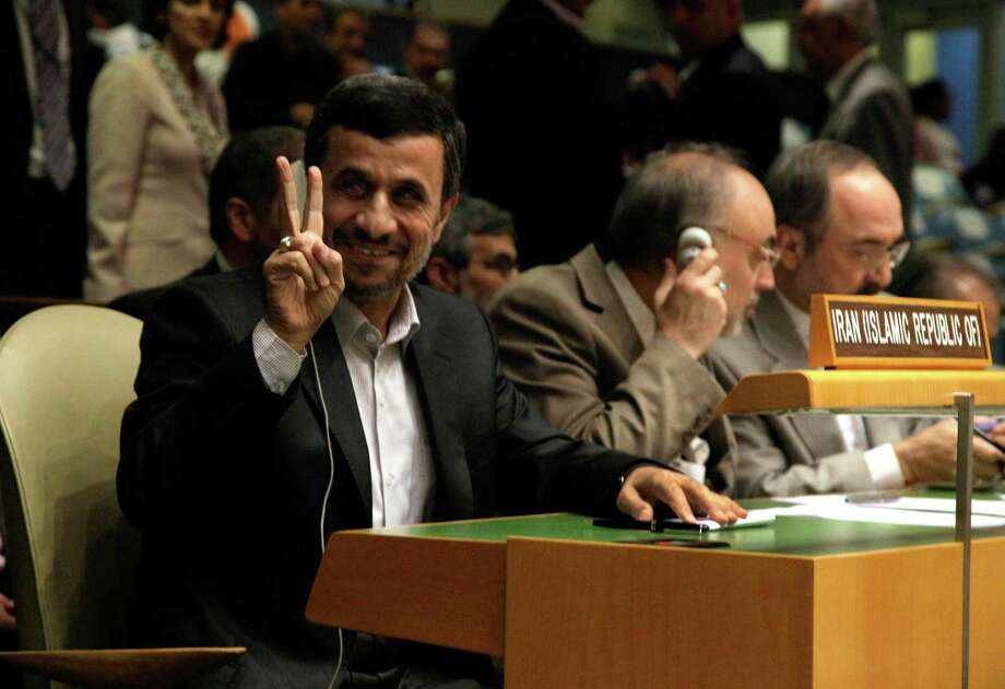 Iran's President Mahmoud Ahmadinejad gestures as he attends the high level meeting on rule of law in the United Nations General Assembly, at U.N. headquarters Monday, Sept. 24, 2012. (AP Photo/Richard Drew) Photo: Richard Drew
