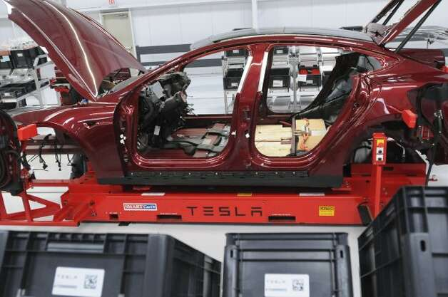 A Tesla Model S sedan waits to be completed at the assembly line at Tesla's factory in Fremont, Calif., Wednesday, June 13, 2012. On June 22, Tesla Motors will begin delivering its all-electric Model S luxury sedan. It is only the second car ever produced by Tesla, and first to be built at Tesla's own factory. (Erik Verduzco / Special to The Chronicle)