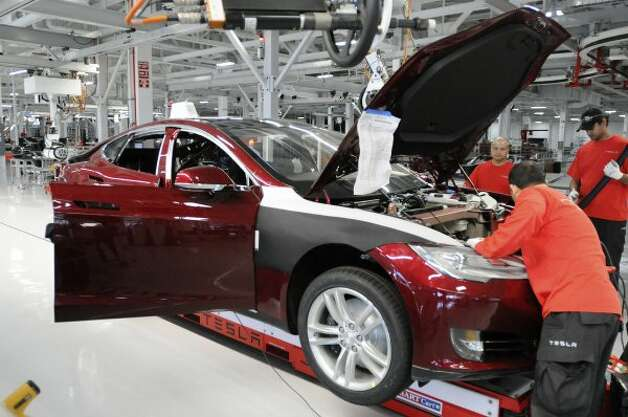 Assembly line workers build a Tesla Model S sedan at Tesla's factory in Fremont, Calif., Wednesday, June 13, 2012. On June 22, Tesla Motors will begin delivering its all-electric Model S luxury sedan. It is only the second car ever produced by Tesla, and first to be built at Tesla's own factory. (Erik Verduzco / Special to The Chronicle)