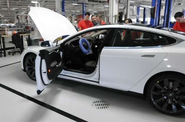 A completed Tesla Model S sedan sits at the end of the assembly line at Tesla's factory in Fremont, Calif., Wednesday, June 13, 2012. On June 22, Tesla Motors will begin delivering its all-electric Model S luxury sedan. It is only the second car ever produced by Tesla, and first to be built at Tesla's own factory. (Erik Verduzco / Special to The Chronicle)