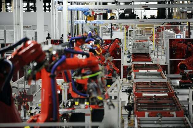 Machines are used to assemble parts for Tesla's Model S sedan at the factory in Fremont, Calif., Wednesday, June 13, 2012. On June 22, Tesla Motors will begin delivering its all-electric Model S luxury sedan. It is only the second car ever produced by Tesla, and first to be built at Tesla's own factory. (Erik Verduzco / Special to The Chronicle)