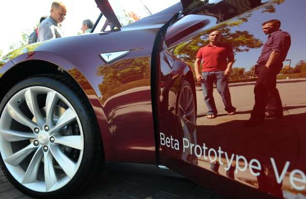 A Tesla Beta Prototype electric car is on display after an annual shareholders meeting at the Computer History Museum in Mountain View on Wednesday, June 6, 2012. (Susana Bates / Special to The Chronicle)