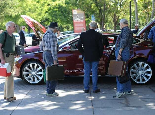 People look at a Tesla Beta Prototype electric car after an annual shareholders meeting at the Computer History Museum in Mountain View on Wednesday, June 6, 2012. (Susana Bates / Special to The Chronicle)