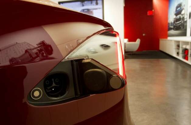 The electric port is shown on the Model S at the Tesla Gallery in the Galleria Thursday, Oct. 20, 2011, in Houston. Electric cars made by Tesla are the main attractions in the gallery. ( Brett Coomer / Houston Chronicle ) (Brett Coomer / Houston Chronicle)