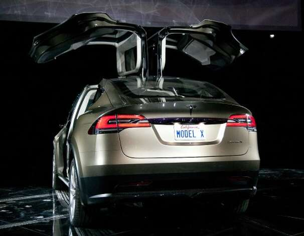 Tesla Motors Inc.'s Model X vehicle is unveiled at Tesla's design studio in Hawthorne, California, U.S., on Thursday, Feb. 9, 2012. The Model X, touted by Tesla as faster than Porsche AG's 911 sports car and roomier than Audi AG's Q7 SUV, will be built in 2013 at the company's Fremont, California, plant that starts making the Model S this year. Photographer: Tim Rue/Bloomberg (Tim Rue / Bloomberg)