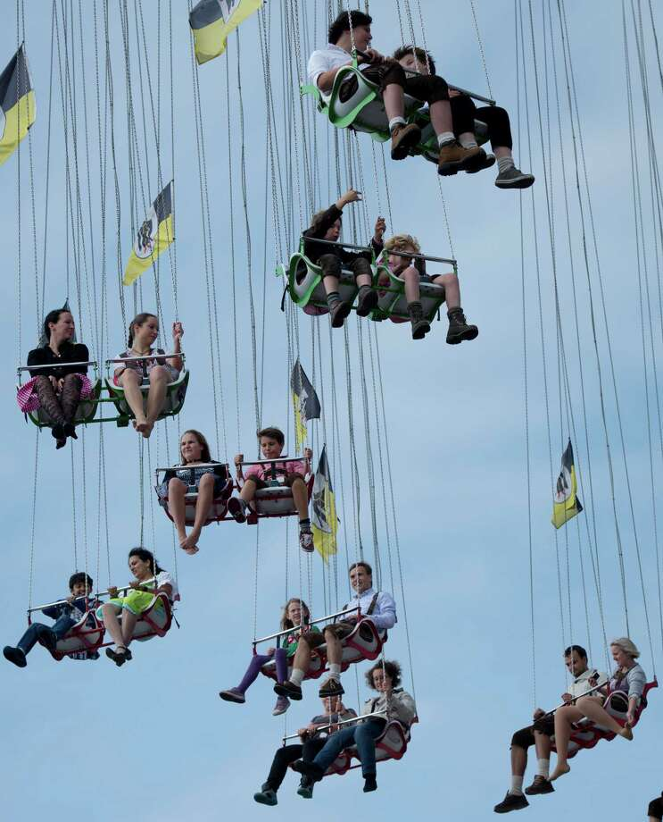 Visitors enjoy a ride on a merry-go-round at the Oktoberfest beer festival in Munich, southern Germany, Sunday, Sept. 23, 2012. The world's largest beer festival, to be held from Sept. 22 to Oct. 7, 2012 will see some million visitors. (AP Photo/Maja Hitij/dapd Photo: Maja Hitij, Associated Press / dapd