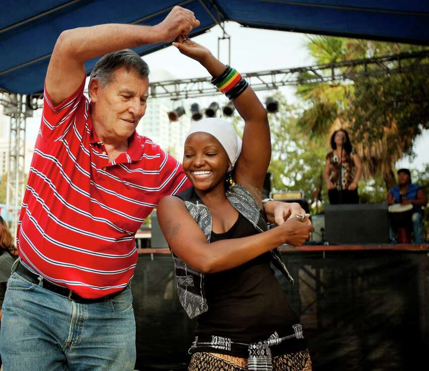 2011: Victor Kent, left, from Houston, and Tida Rodrigues, from Cape Verde, dance to the music of Joao Cerilo during the International Accordion Festival at La Villita.