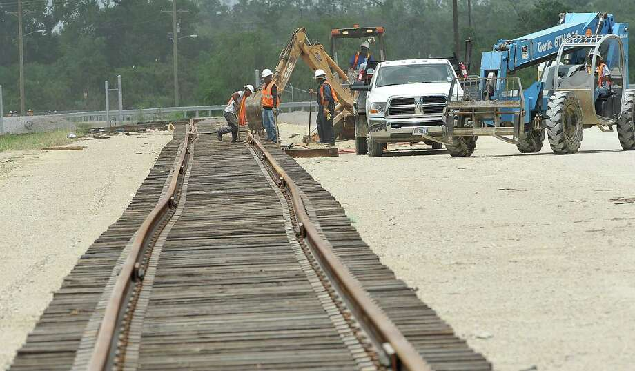 Work continued Monday July 2, 2012 on railroad tracks alongside the road leading into the Port of Beaumont's Orange County property which is progressing. The contractor will have 100 working days to complete the new road, which will bring it very close to the start of the Neches River Bridge project. The port's development of the Orange County property is continuing as well. Dave Ryan/The Enterprise Photo: Dave Ryan