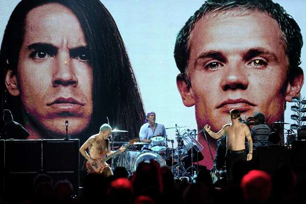 Inductees (l to r) Flea, Chad Smith and Anthony Kiedis of The Red Hot Chili Peppers performonstage during the 27th Annual Rock And Roll Hall of Fame Induction Ceremony at Public Hall on April 14, 2012 in Cleveland, Ohio. Photo: Getty Images