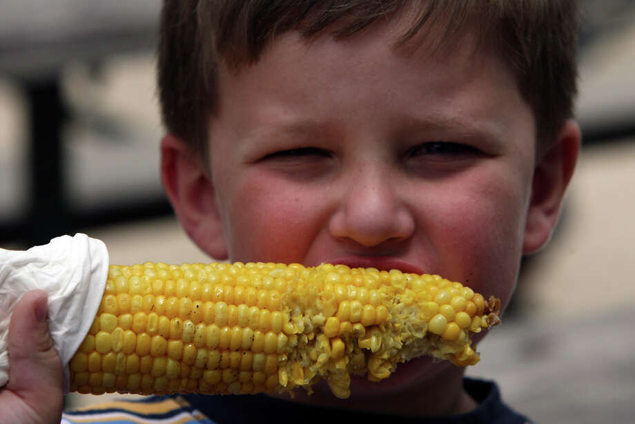 James Wilsey, 4, digs in to some corn on the cob at the annual Helotes Cornyval on Sunday May 4, 2008. Wilsey was there with his mom and dad, John and Kirstin Wilsey. Photo: JOHN DAVENPORT, SAN ANTONIO EXPRESS-NEWS / jdavenport@express-news.net