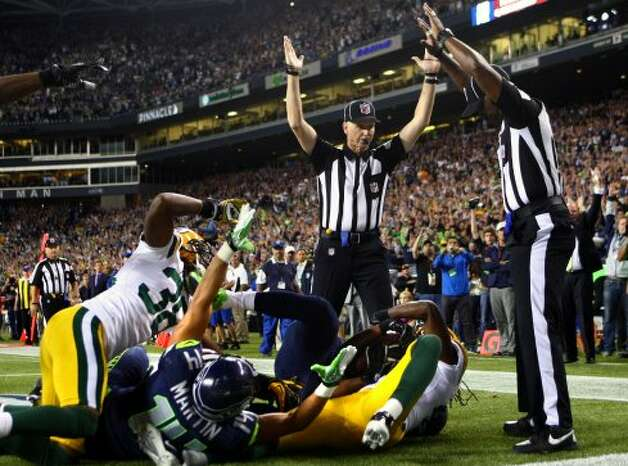 A blown call by replacement referees at the end of the Seattle Seahawks-Green Bay Packers game Monday night gave Seattle a 14-12 win, and sent social and sports media ablaze. Here are some other bad calls.  (AP/Seattlepi.com)