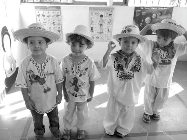 "Ann Caron's grandson Marley, second from left, wears ""traje tipico,"" traditional Nicaraguan dress, at his school in Nicaragua, which was celebrating Central American Independence Day. Photo: Contributed Photo"
