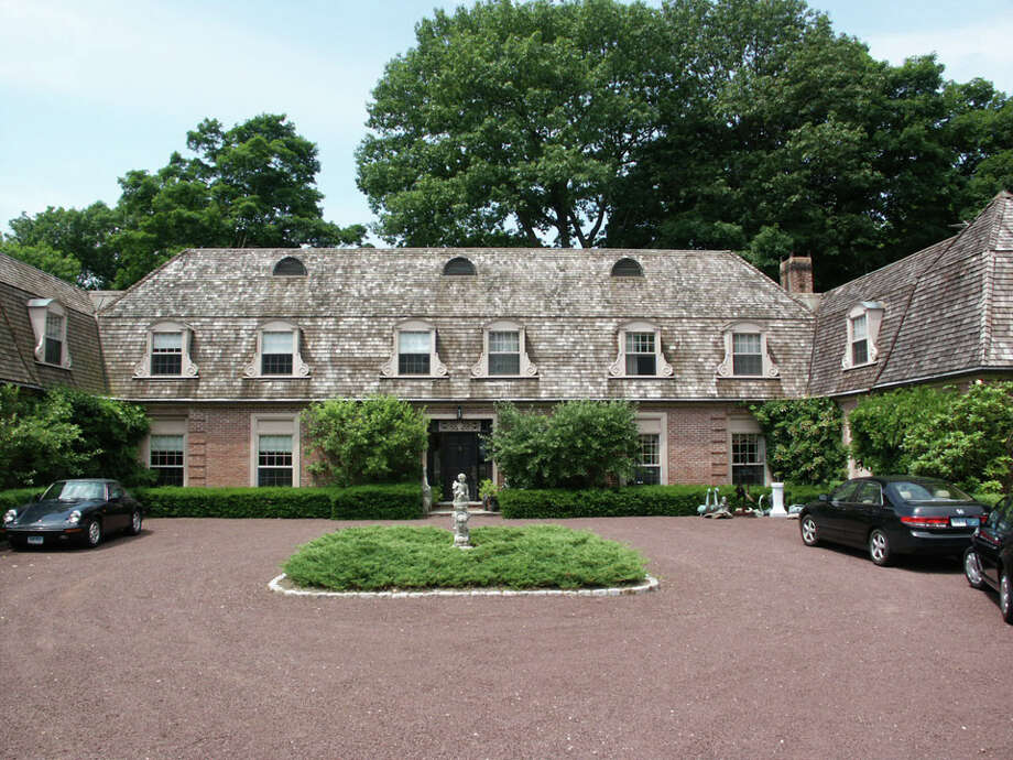 Hilton-VanderHorn Architects, owned by Darien residents Charles Hilton and Douglas VanderHorn, has been selected as the winner of the 2012 ìAt Homeî A-List award competition. The firm was honored for its design of a French Manor-style home on a beaucolic 4-acre site in Greenwich. Above left, before renovation, and above right, after. Photo: Contributed