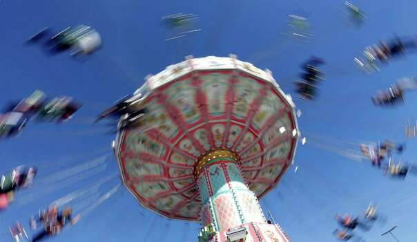 Visitors enjoy a ride in a carousel on a sunny day at Oktoberfest. (AP Photo/Matthias Schrader) Photo: Ap/getty
