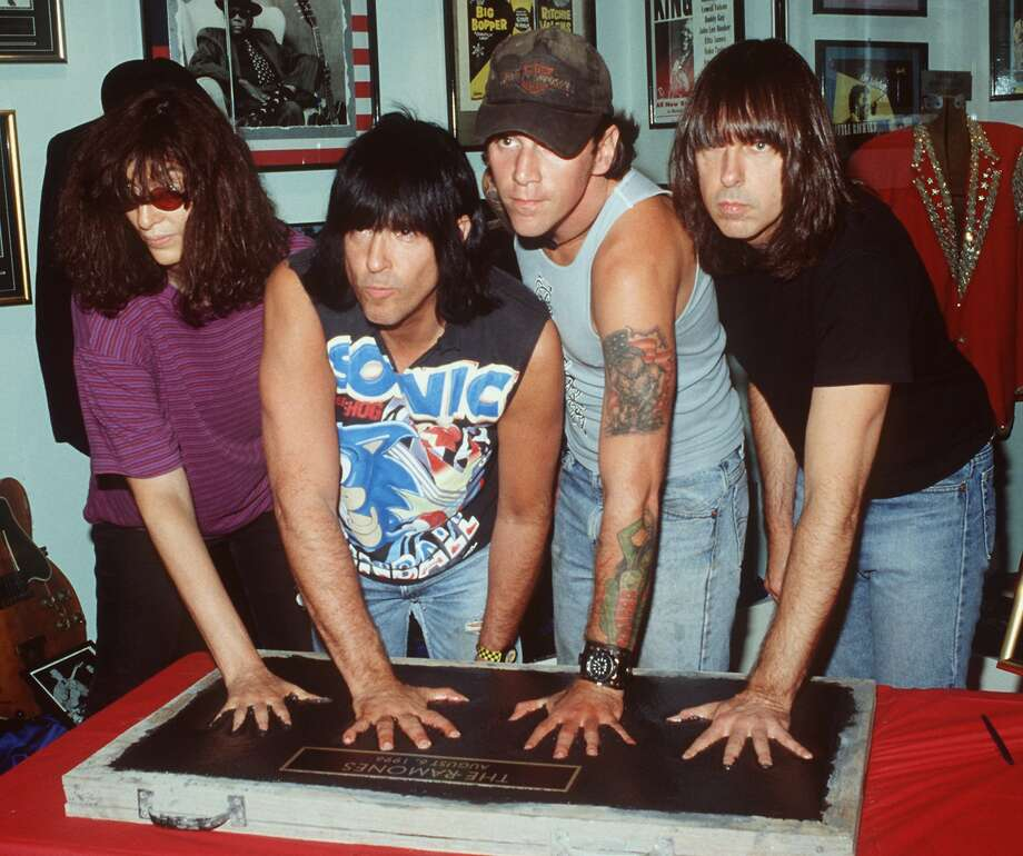 "Johnny Ramone, far right, broke away from typically left-wing punk rock politics in 2002, when the Ramones were inducted into the Rock and Roll Hall of Fame. The Republican-voting Ramone said ""God bless President Bush, and God bless America."" Photo: Robert Rockwalk/AP"