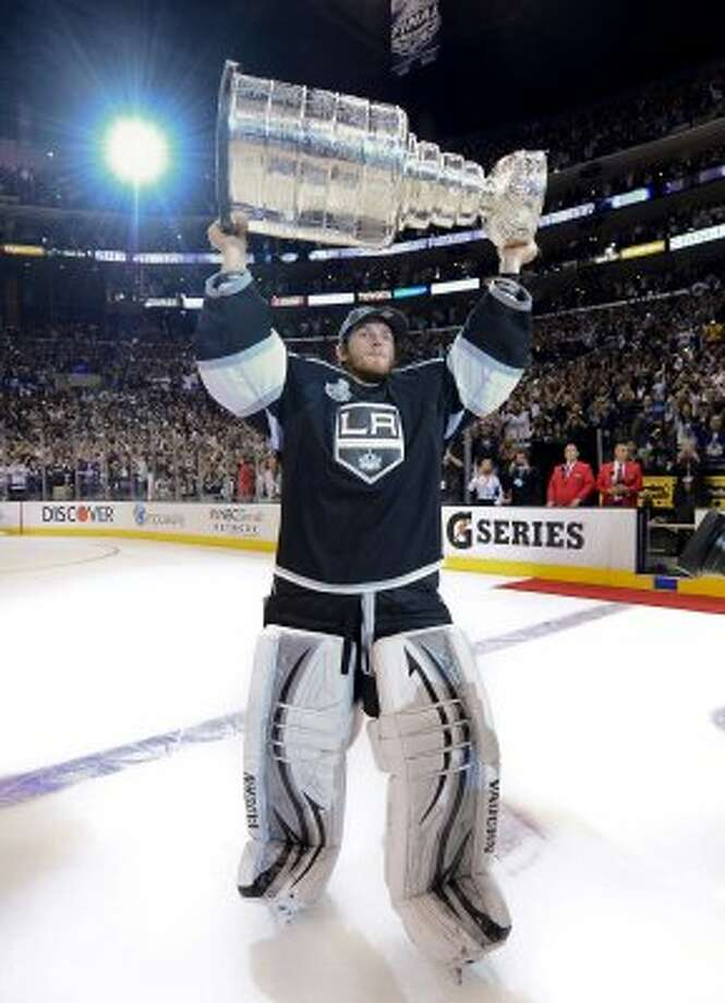 Los Angeles Kings goalie Jonathan Quick holds up the Stanley Cup after the Kings beat the New Jersey Devils 6-1during Game 6 of the NHL hockey Stanley Cup finals, Monday, June 11, 2012, in Los Angeles. (AP Photo/Mark J. Terrill) (Associated Press)