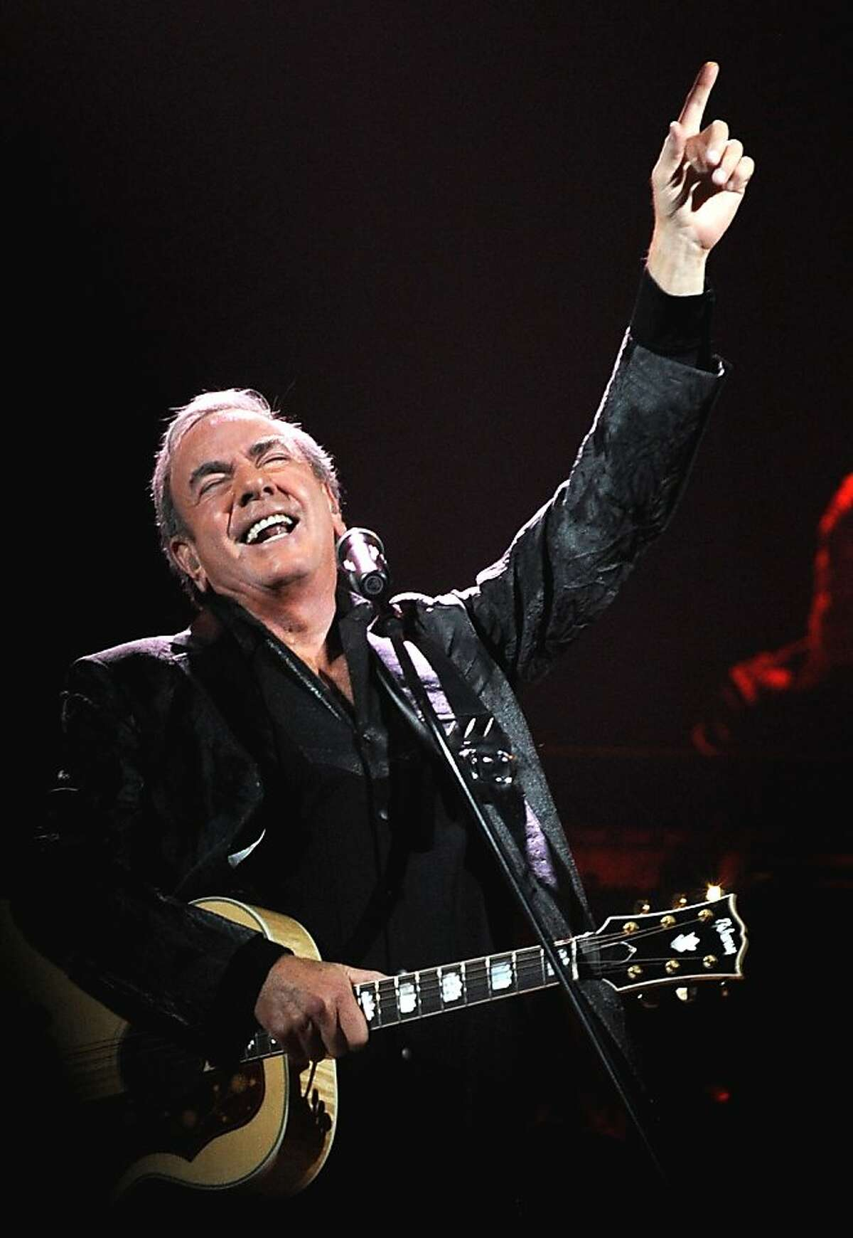 In this photo provided by the Las Vegas News Bureau, after 5 decades of performing, being inducted into the Songwriter Hall of Fame and Rock and Roll Hall of Fame Neil Diamond packs the house at the MGM Grand Arena on the Las Vegas Strip Saturday, Sept. 1, 2012. (AP Photo/Las Vegas News Bureau, Glenn Pinkerton)