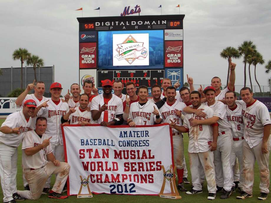 The 2012 World Series Champions Albany Athletics pose with banner and trophy. Pictured, from left, manager/GM Joe Altieri, Craig Mastroianni (kneeling), JJ Pearsall (behind), Mike Hughes, Ben Paniccia, Al Barbato, Ryan White, Drew Cody, Bill Lawton, Zach Halloran, Greg Sulz, Justin Meagher, Mike Tirri, Mark Teson, Chris Smith, Dan Barbero, Pat Landers, Jason Martin, John Kelly and Justin Harris. Not pictured: Shawn Ryan, Jim Shook, AJ Ragone, Will Cardona and Eric Biehler.
