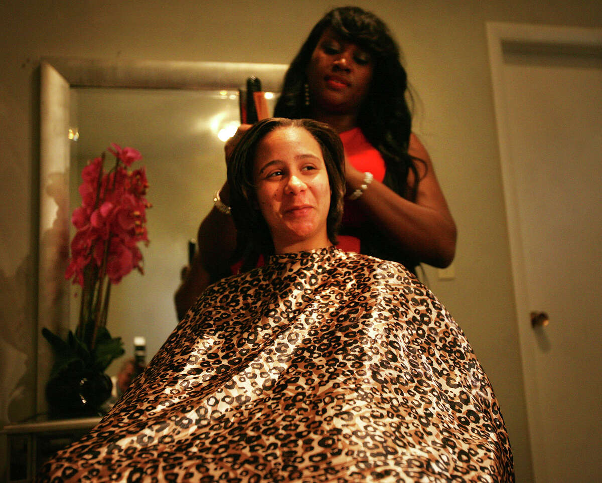 Melissa Huggins, 28 of Shelton, has her hair done by Tanisha Akinloye as part of a day of beauty makeovers put on by the non-profit organization Empowering Through Beauty in Bridgeport on Tuesday, September 25, 2012.