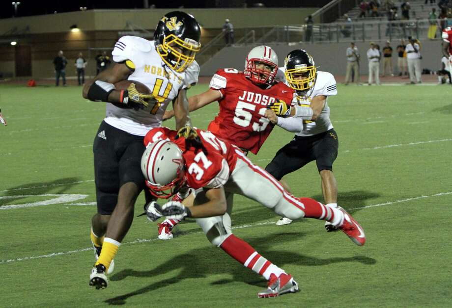 Judson's Shawn Calvin, (37) takes down East Central receiver Vernest Dotson (4) following a catch Friday, in Judson's 28-18 win at Rutledge Stadium. Photo: Greg Bell / For The NE Herald