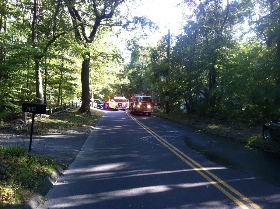 A woman in her 80s was pulled from her burning home on Booth Hill Road in Trumbull, Conn. on Tuesday, Sept. 25, 2012. Photo: Tom Cleary