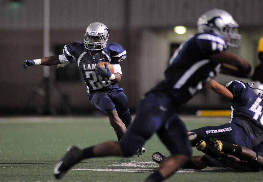 Lamar Consolidated senior running back Keshon Leonard, left, will try to get the Mustangs back on track against neighborhood rival Terry, led by quarterback Kishawn McClain, right. Photo: Jerry Baker