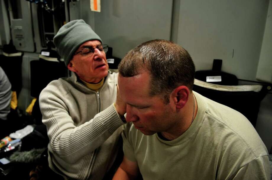 "U.S. Air Force Col. Dr. Richard C. Niemtzow uses acupuncture on a patient in a Washington, D.C. Veterans Administration hospital in a scene from ""Escape Fire.""  Dr. Niemtzow will appear at the Q&A at the Ridgefield Playhouse Film Society screening on Saturday, Sept. 29. Photo: Contributed Photo"