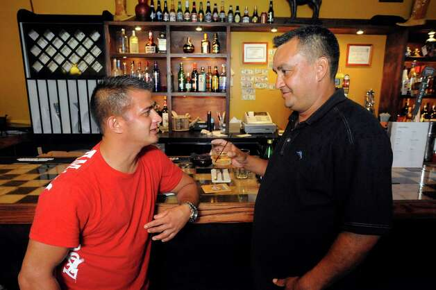 Leonel Guerra, left, and Carlos Ayala, talk at the bar in Ortega's Restaurant & Diner in Danbury Tuesday, Sept. 18, 2012. Photo: Michael Duffy
