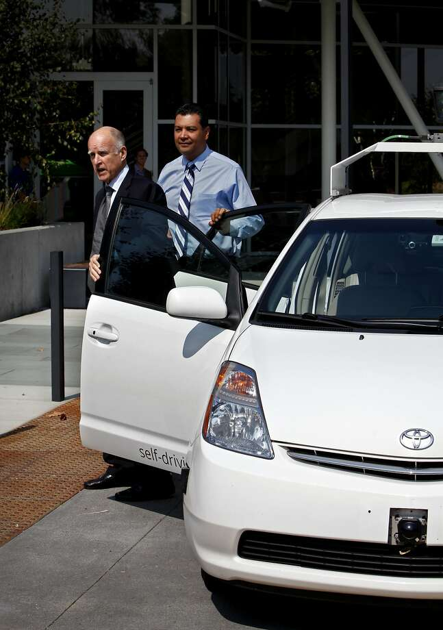 Gov. Jerry Brown arrives at Google headquarters in a Google driverless car in Mountain View, Calif., Tuesday, September 25, 2012.  Gov. Brown signed a new bill regulating the ability of still-experimental driverless vehicles to operate on California roads. Photo: Sarah Rice, Special To The Chronicle