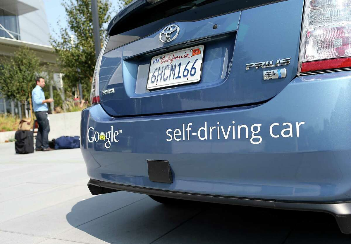 A Google self-driving car is displayed at Google headquarters in Mountain View.