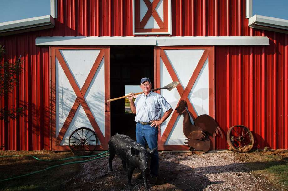 "Larry Emerson (aka Farmer Dewberry) stands in front of a barn at Dewberry Farm, which opens for the season on Saturday. The business is celebrating 10 years of offering clean, country ""Agri-tainment"" to farm fans. Photo: Michael Paulsen / © 2012 Houston Chronicle"