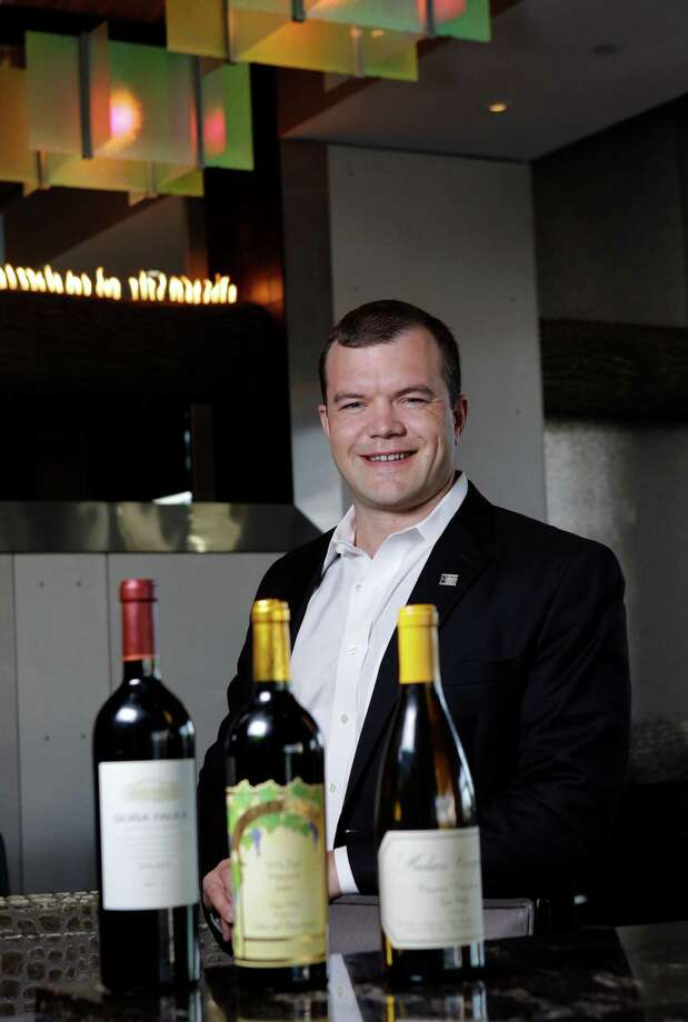 Certified Wine Educator Ben Roberts, the sommelier at Masraff's on Post Oak, displays his Iron Sommelier-winning wines. Photo: Melissa Phillip / © 2012 Houston Chronicle