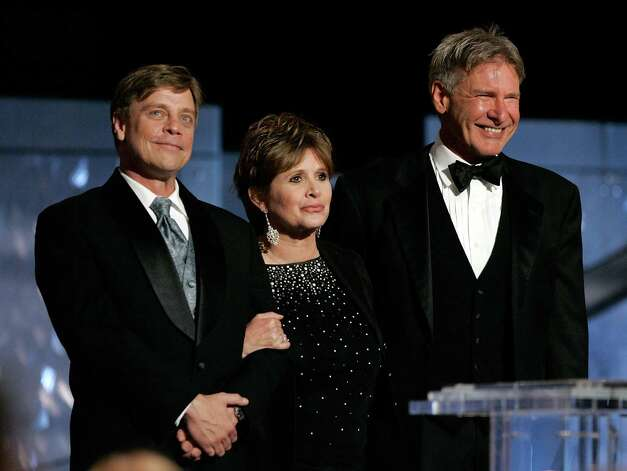 "Here are Mark Hamill, Carrie Fisher and Harrison Ford onstage during the 33rd AFI Life Achievement Award tribute to ""Star Wars"" creator George Lucas at the Kodak Theatre on June 9, 2005 in Hollywood. Photo: Vince Bucci, Getty Images / 2005 Getty Images"