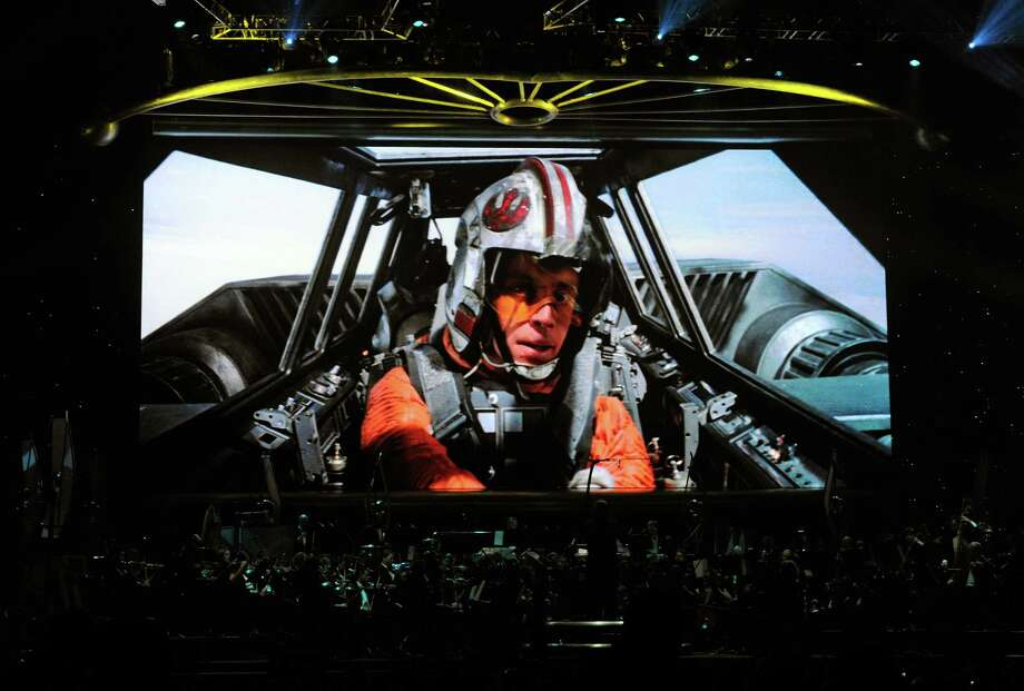 "Mark Hamill, as Luke Skywalker, appears in ""The Empire Strikes Back,"" shown on screen while musicians perform during ""Star Wars: In Concert"" at the Orleans Arena May 29, 2010 in Las Vegas. Photo: Ethan Miller, Getty Images / 2010 Getty Images"