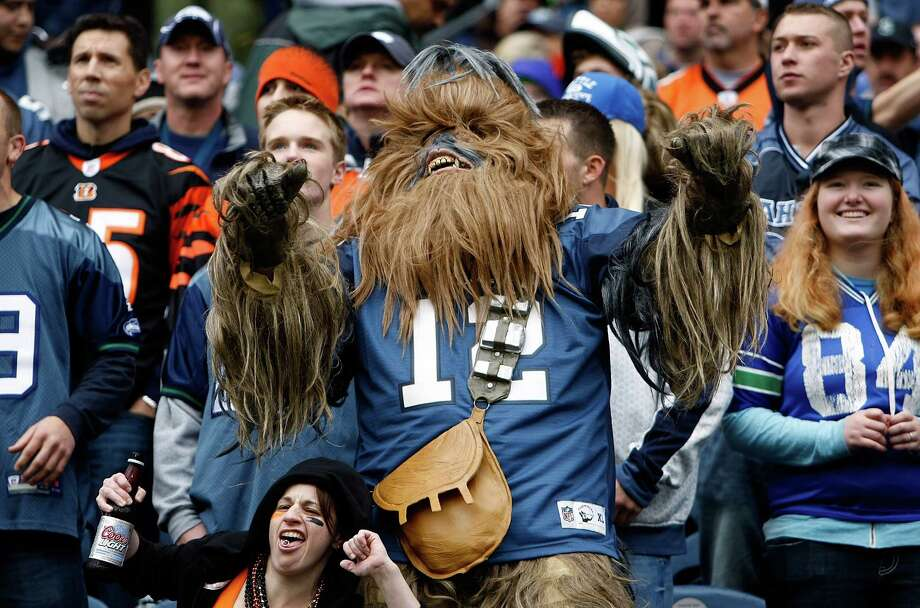 And Chewbacca's apparently a Seattle Seahawks fan. At least, he got in the 12th-man spirit of things at the game against the Cincinnati Bengals on October 30, 2011 at Century Link Field in Seattle. Photo: Jonathan Ferrey, Getty Images / 2011 Getty Images
