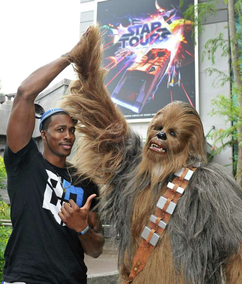 "Han Solo's partner, Chewbacca, doesn't look a day older. Here he is partying it up with Orlando Magic center Dwight Howard in front of the new ""Star Tours - The Adventures Continue"" attraction, on May 6, 2011, at Disney's Hollywood Studios in Lake Buena Vista, Fla. Photo: Getty Images"
