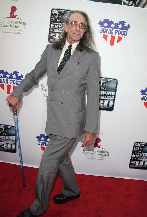 "Here's Peter Mayhew arriving at St. Jude's 30th anniversary screening of ""The Empire Strikes Back"" on May 19, 2010  at Arclight Cinema in Los Angeles. Check out the lightsaber cane. Photo: Angela Weiss, Getty Images / 2010 Getty Images"