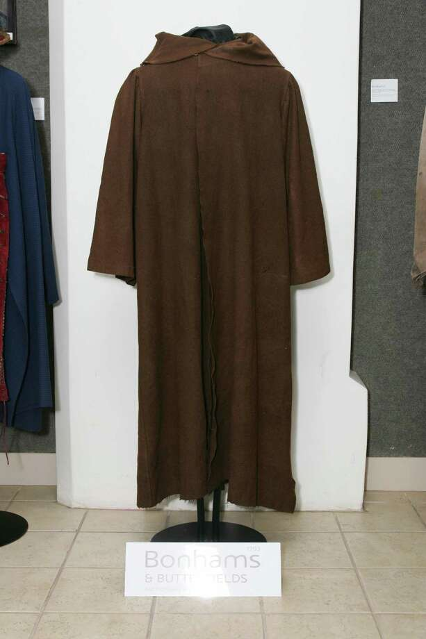"Alec Guinness died in 2000, so his ""now"" shot may be best represented as Obi-Wan Kenobi's empty cloak. Photo: ROBYN BECK, AFP/Getty Images / 2007 AFP"