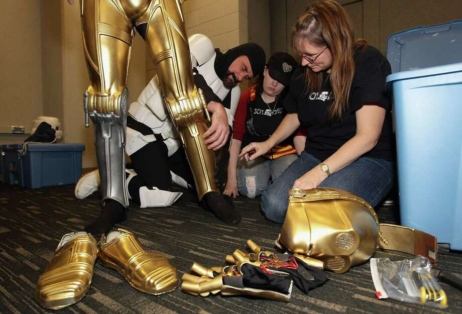 "C-3PO was also at the game, although he apparently fell into the same sort of difficulties as he suffered when he was disassembled in ""The Empire Strikes Back."" Photo: Christian Petersen, Getty Images / 2011 Getty Images"