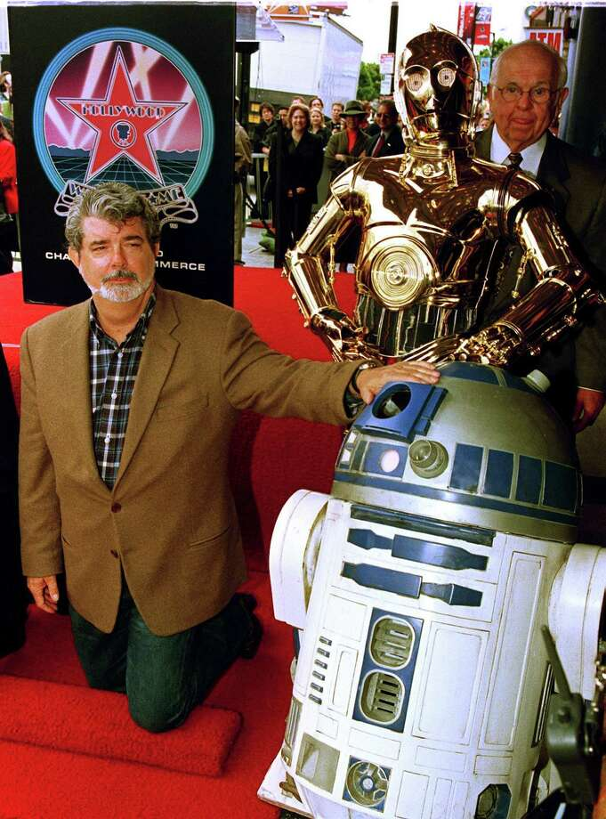 """The droid R2-D2 lived the high life for a while after the first three """"Star Wars"""" films. He was on hand with buddy C-3PO and Star Wars creator George Lucas on June 3, 1999, when special effects supervisor Dennis Muren recieved a star on the Hollwood Walk of Fame. Photo: Vince Bucci, AFP/Getty Images / AFP"""