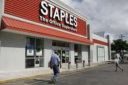 FILE-Private equity firm Sycamore is buying office supplies chain Staples for $6.9 billion. The companies said Wednesday that shareholders of Framingham, Massachusetts-based Staples will get $10.25 per share.