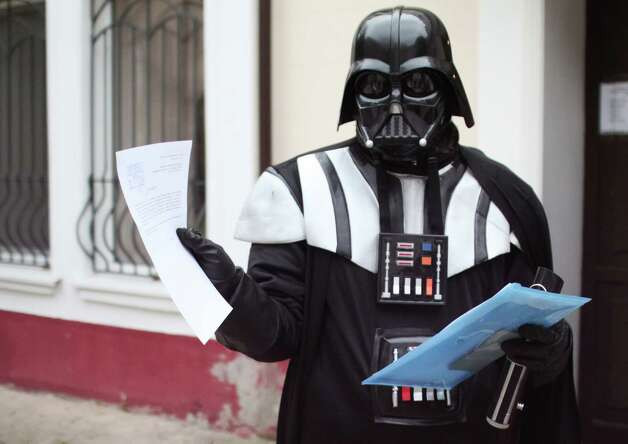Apparently, Darth Vader decided to settle down in Odessa, Ukraine. Here, he shows papers outside of Odessa's city hall, where he  demanded a plot of land on which to park his spaceship on November 18, 2011. Photo: STR, AFP/Getty Images / 2011 AFP