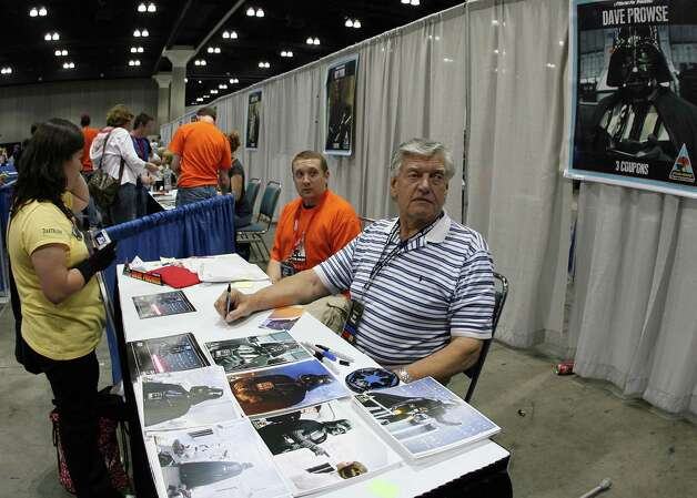 "David Prowse signs autographs during the opening day of ""Star Wars Celebration IV"" in Los Angeles on May 24, 2007. One note, when Vader reverts to Anakin Skywalker in death in ""Return of the Jedi,"" that's actor Sebastian Shaw. Photo: GABRIEL BOUYS, AFP/Getty Images / 2007 AFP"