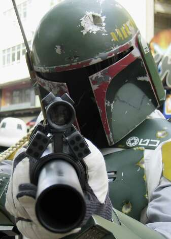 "And here's Boba Fett outside the Empire cinema to celebrate the London premiere of the final part of the Star Wars series, ""Revenge of the Sith,"" on May 16, 2005 in London. Photo: Jim Dyson, Getty Images / 2005 Getty Images"